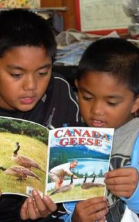 KIDS ENJOYING READING CANADA GEESE BY SPYROS PETER GOUDAS