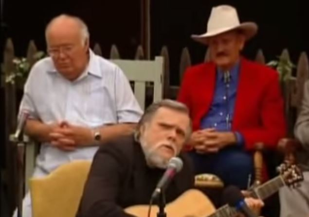 Spyros Peter Goudas  As we are in this section of the website, I would like you to link into some old time favourites.  JOHNNY PAYCHECK Old Rugged Cross While singing, Johnny Paycheck is surrounded by some of the biggest stars in Country Music history.