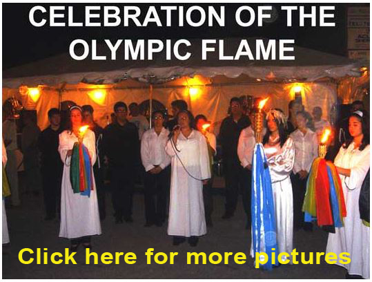 The festivities included the Olympic Torch Flame ceremony, in which young women dress according to tradition for the event.   In some pictures you can see the priest (Peter Mentis) and president of the association (Dimitrios Tsatsaronis) (Agnes Kostopoulos) participating in the ceremony.
