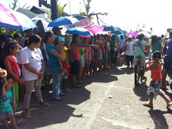 Mr. Goudas - People waiting to receive necessities (Philippines)